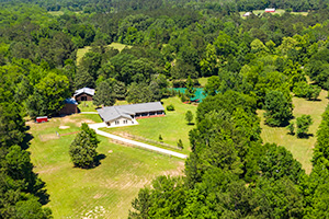 Impeccably Improved 9+ Acre Pineywoods Farm